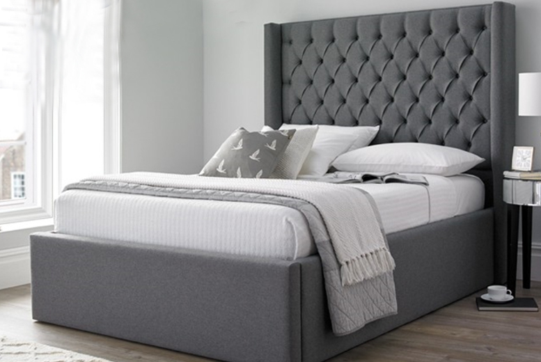 From £299 for a single, small double (£334.99), double (£344.99) or king (£364.99) Winged Bed with Chesterfield Fabric Headboard from Dreamtouch Mattresses LTD – save up to 63%