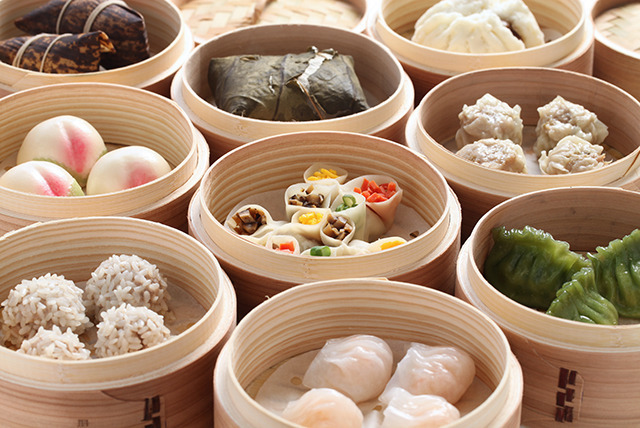 £12 instead of up to £41.70 for 6 dim sum dishes to share between 2 people and a glass of wine each at New China London, Gerrard Street - save 71%