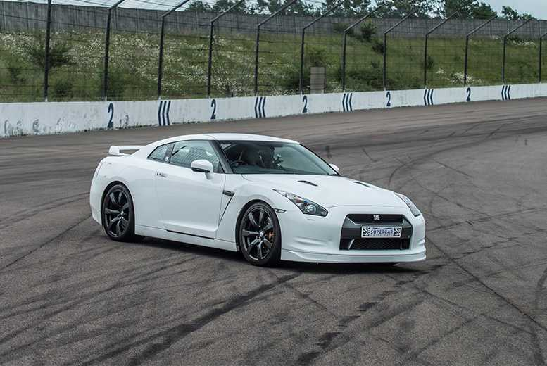 Activities: Nissan GTR or BMW i8 3-Lap Supercar Experience - Premium Track!