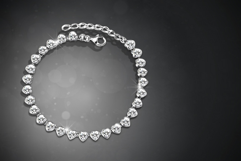 £12 instead of £69.99 (from Marcus Emporium) for a Swarovski Elements heart tennis bracelet - save a sparkling 83%