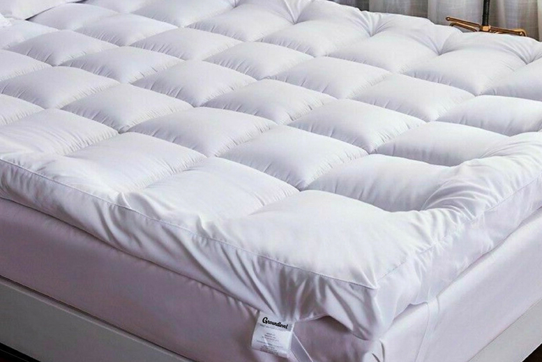 £26.99 instead of £79.99 (from Groundlevel) for an luxury extra-thick duck feather and down mattress topper – choose from four sizes and save up to 66%