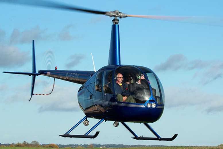 £29 for a 10-mile helicopter buzz flight experience with Heli Air from Fairoaks Airport, Surrey