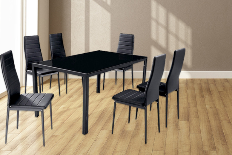 £149 instead of £380 (from xsuk.co.uk) for a Berlin black glass-top dining table with 6 faux-leather chairs - save 61%
