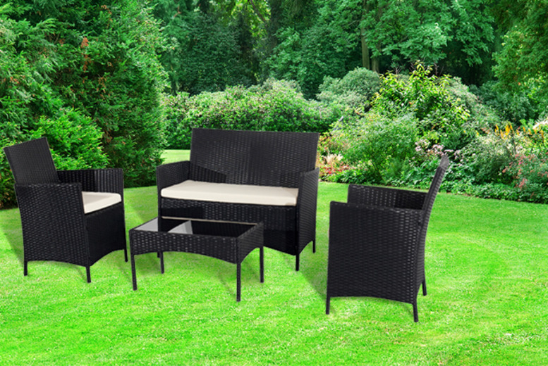 £199 for a 4-piece rattan garden furniture set including 2-seater sofa, 2 chairs and coffee table in black or brown from Wowcher Direct