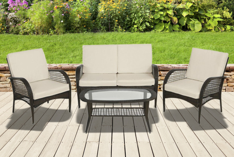 £229.99 for a 4-piece Linden rattan set including a sofa, two chairs, glass-topped table and all cushions from Wowcher Direct - save £100.01!