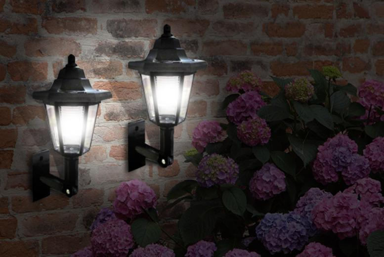 £9.99 instead of £39.99 for 2 LED solar power wall lamps from Wowcher Direct - save 75%