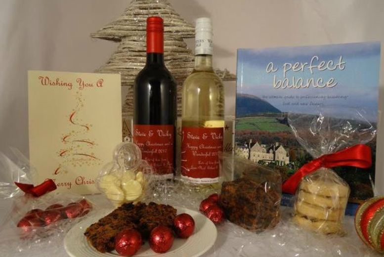 £39 instead of £109.95 for a personalised deluxe Christmas hamper including wine, treats and a personalised gift card from Coghlans Cookery School - save 65%