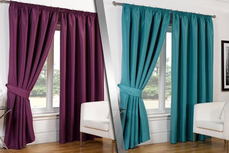 From £11.99 for a pair of faux silk blackout curtains in a choice of colours and sizes from Wowcher Direct - save up to 76%