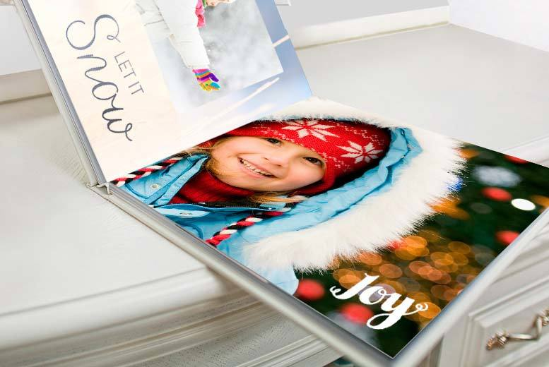 "£15 instead of £84.59 (from Truprint) for an 11"" x 8"" 100-page custom cover hardback personalised photobook - save 82%"