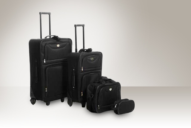 £49 for a lightweight black four piece luggage set from Mail Shop + FREE DELIVERY