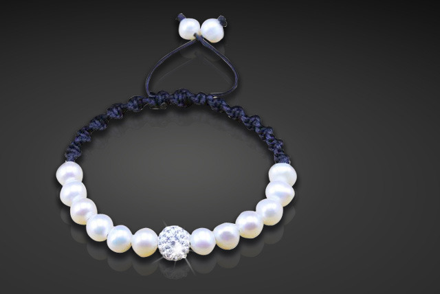 £8 for a faux pearl cord friendship bracelet featuring a diamante ball from The Real Silver Company