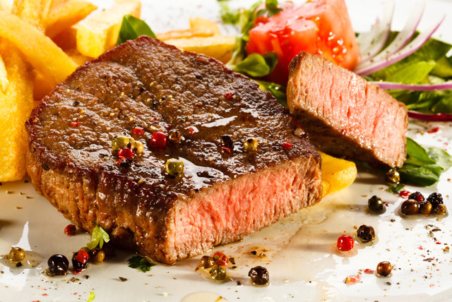 £10 instead of up to £26.70 for a 2 course fusion meal for 2 inc. starter, main & side each at K&S Reign, Streatham - save up to 63%