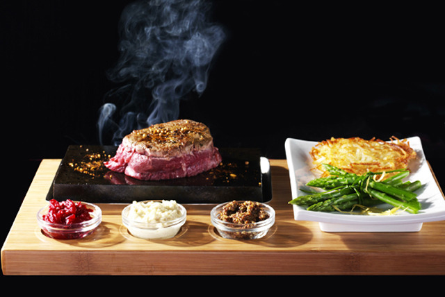£27 instead of up to £54.80 for a hot stone 2-course steak meal for 2 with a small glass of wine each at Rango's - save up to 51%