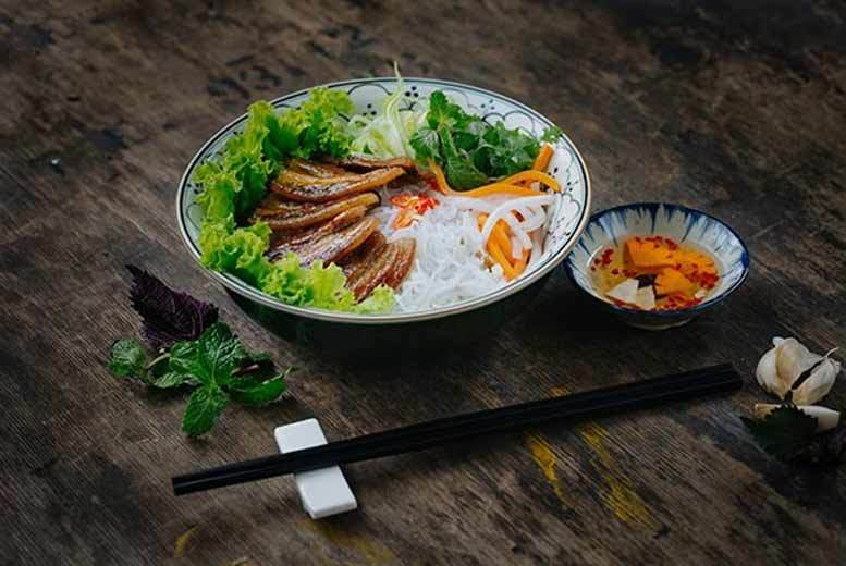 £49 for a four-course Vietnamese and glass of wine for two at Pho & Bun, Soho from Buyagift!