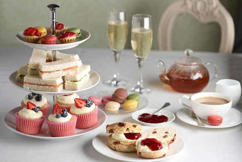 £22 instead of £37 for afternoon tea for two with a glass of Prosecco each, £44 for four at The Bridge Hotel, Prestbury - save up to 41%
