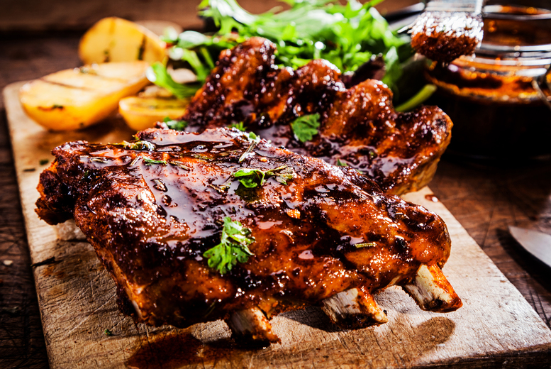 £14 instead of £21.80 for half a rack of ribs and a Carlsberg each for two people at Bar Sports, Derby - save 39%