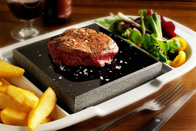 £8 instead of up to £16.90 for a hot stone steak meal inc. chips, salad & a glass of wine at Steakhouse, Watford - save 53%