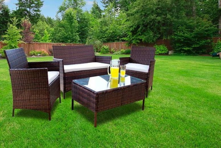 4pc rattan garden furniture set 2 colours deck your conservatory garden or patio with a four piece furniture set comprising a stylish rattan two seater