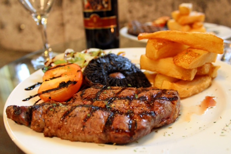 £18 instead of £37.90 for two sirloin steak meals and a bottle of house wine for two, or £35 for four at The Mitre Hotel, Manchester city centre - save up to 53%
