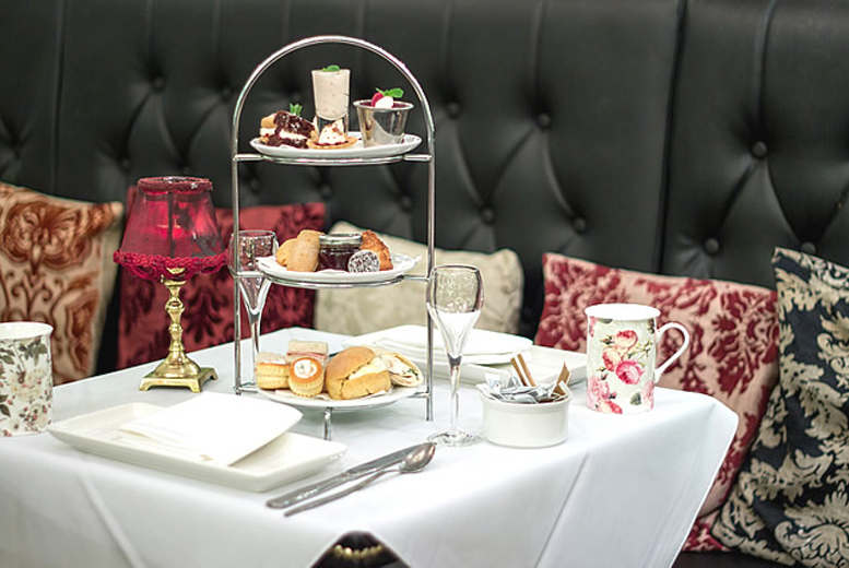 From £20 for afternoon tea for two people, from £40 for four people at AMPM Restaurant, Belfast - upgrade to include a glass of bubbly each and save up to 41%