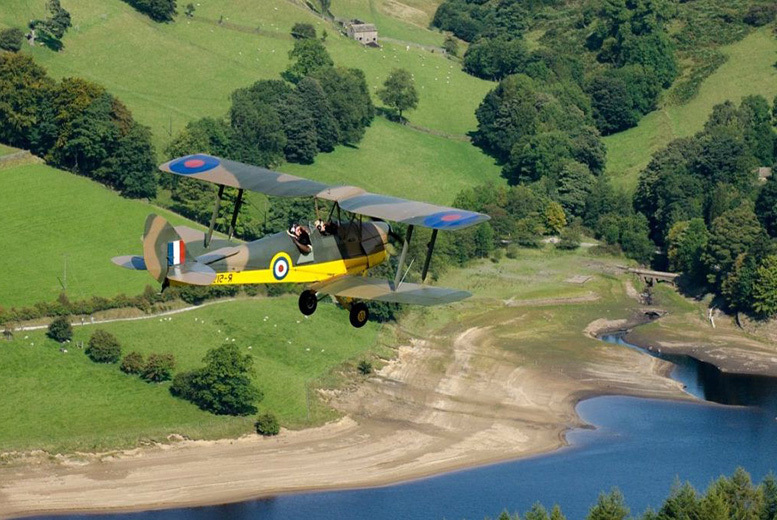 £89 for a WW2 aircraft flight experience for one person with bubbly, uniform hire and framed photograph or £175 for two people with Blue Eye Aviation - save up to 54%