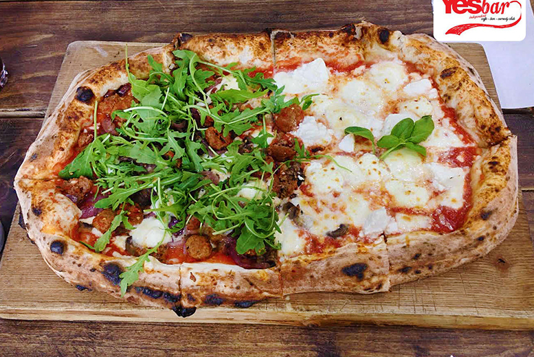 £10 instead of up to £50 for a starter, half-metre pizza to share and comedy club ticket each for two people at Yes Bar, Central Glasgow - save up to 80%